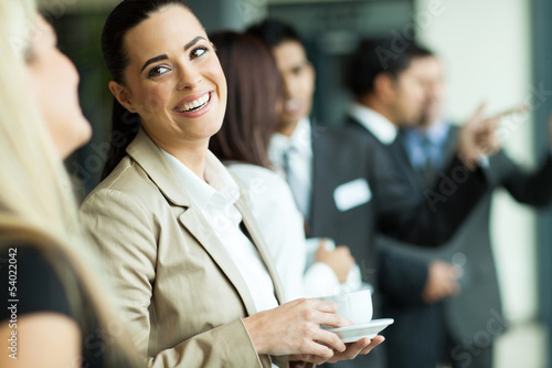 businesswoman having fun conversation with colleague during brea