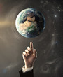 hand pointing at earth