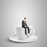 man sitting on cup