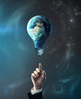hand pointing at lamp earth