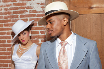 Retro jazz fashion wedding couple in old urban building. Groom i