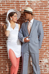 Vintage jazz fashion sexy wedding couple in old urban building.