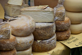 Various cheeses on village market
