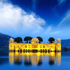 Indian water palace on Jal Mahal lake at night time in Jaipur, I