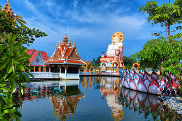 Thailand travel background. Buddha temple pagoda and beautiful t