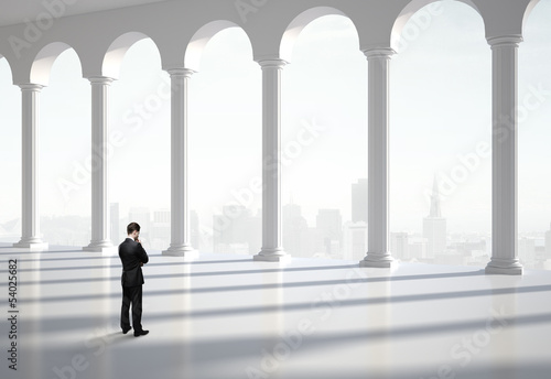 thinking businessman in hall