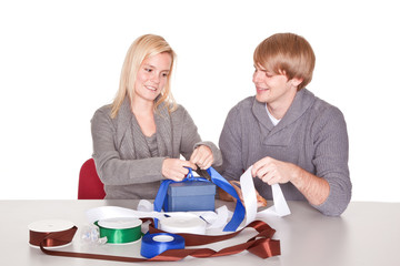 couple wrapping gifts for christmas