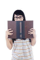 Asian female read book on white