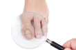 Постер, плакат: Doctor dermatologist examines the nail on the presence of the fu