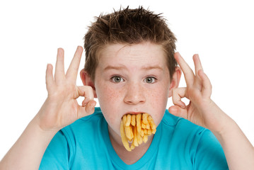 Young Boy with Mouth Full of Chips