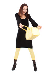 young woman with wellow handbag surprised