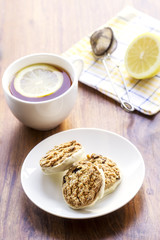 oatmeal raisin cookies and cup of tea