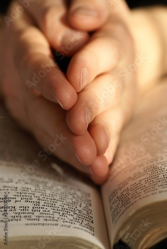 Detail o Holy Bible and hands in prayer