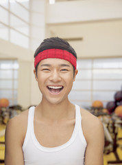 Portrait smiling young man at the gym