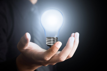 Light bulb in  man hand