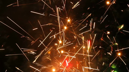 Large firework sparks burning at night fire show
