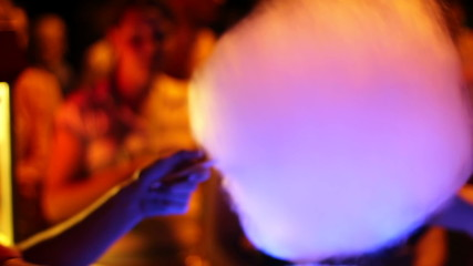 Cotton candy is prepared and bought at night, making process