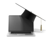Grad hat and laptop