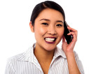 Business woman closing deal over a phone call