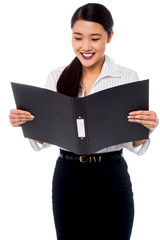 Female assistant reviewing file