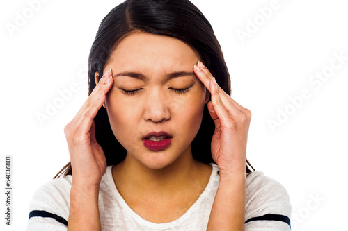 Girl having serious headache
