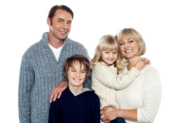 Portrait of friendly family of four in the studio