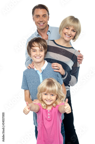 Friendly family of four in the studio