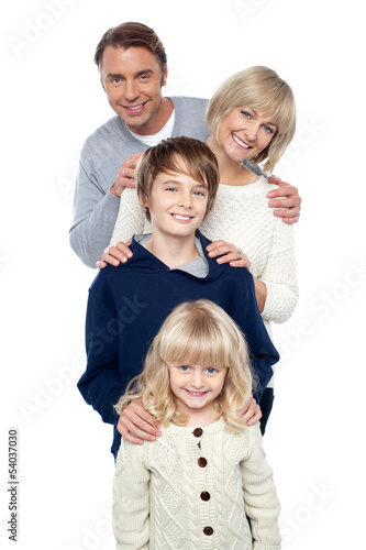 Family of four posing in a row