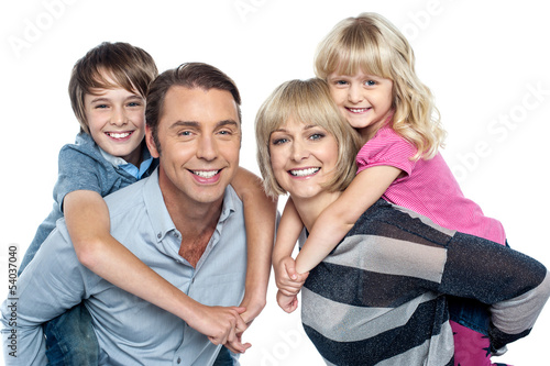 Caucasian family of four in the studio