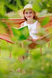Summer joy - girl with a book resting in a hammock