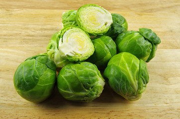 brussel sprouts on wooden chopping board