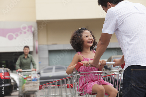 Daughter and father with shopping cart
