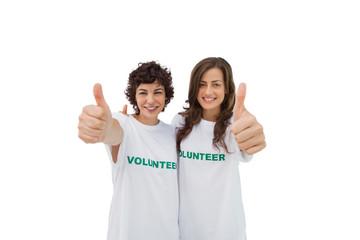 Two happy volunteers giving thumbs up