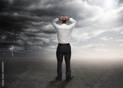 Businessman standing in a desert