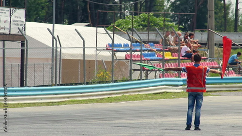 Man with red flag drives cars off track, race finished