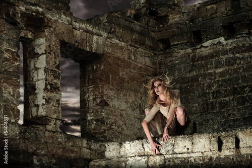Fantasy style portrait of the scary woman in the ruins