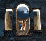 Mysterious female figure in the arc of ruined building poster