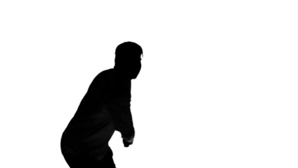 Silhouette of a man playing tennis