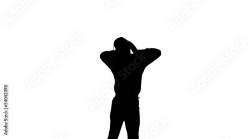 Silhouette of a man enjoying music on white background