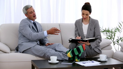 Businessman in socks making an appointment with a colleague
