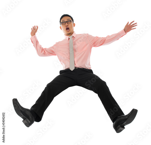 Asian businessman falling backwards