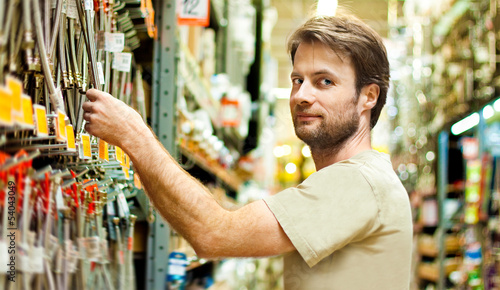 Smiling handyman shopping in DIY outlet