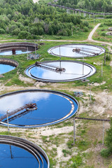 Round form water cleaners in treatment plant, aerial view