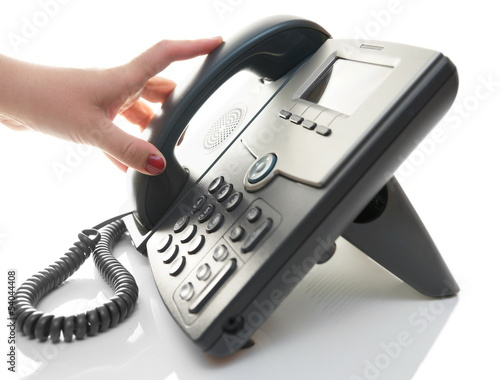 woman hand is pick up the phone