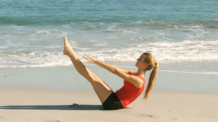 Attractive woman working out on the beach