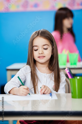 Girl Drawing With Sketch Pen In Preschool