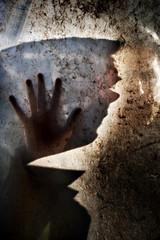Man behind dirty window