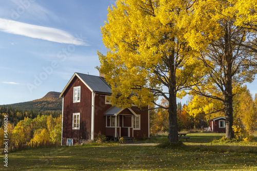 Old cottage in autumn colors