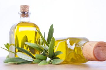 botellas de aceite y rama