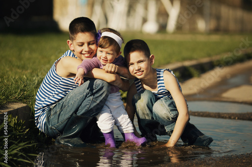 happy children playing in the puddle